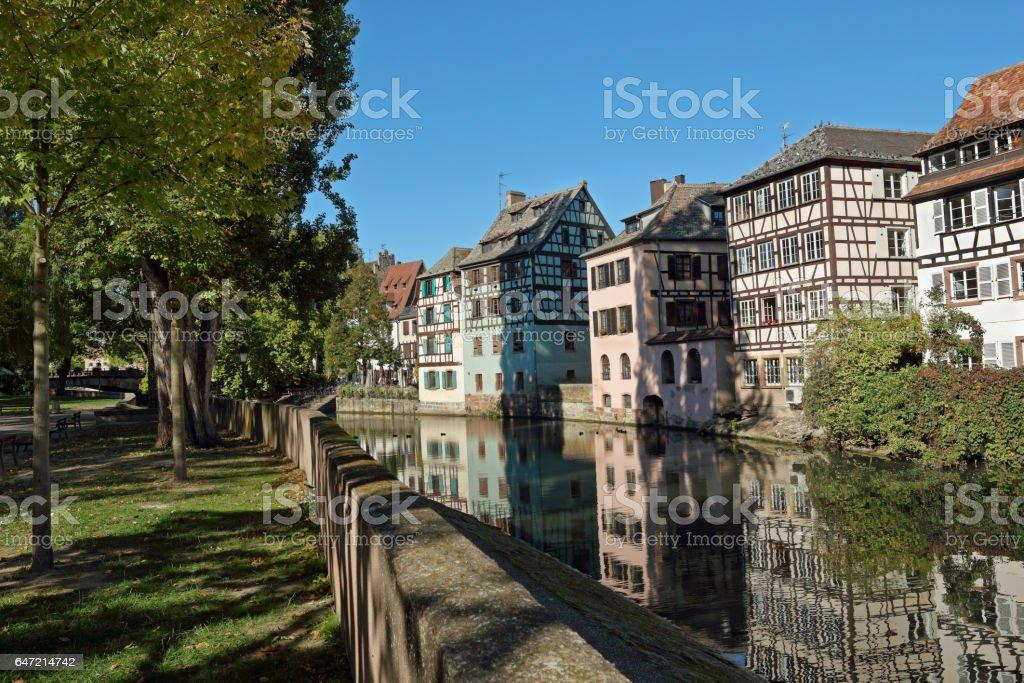 Autumn in Strasbourg: The Quarter La-Petite-France at the river Ill stock photo