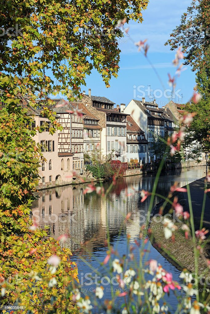 Autumn in Strasbourg: The Quarter La-Petite-France with flowers stock photo