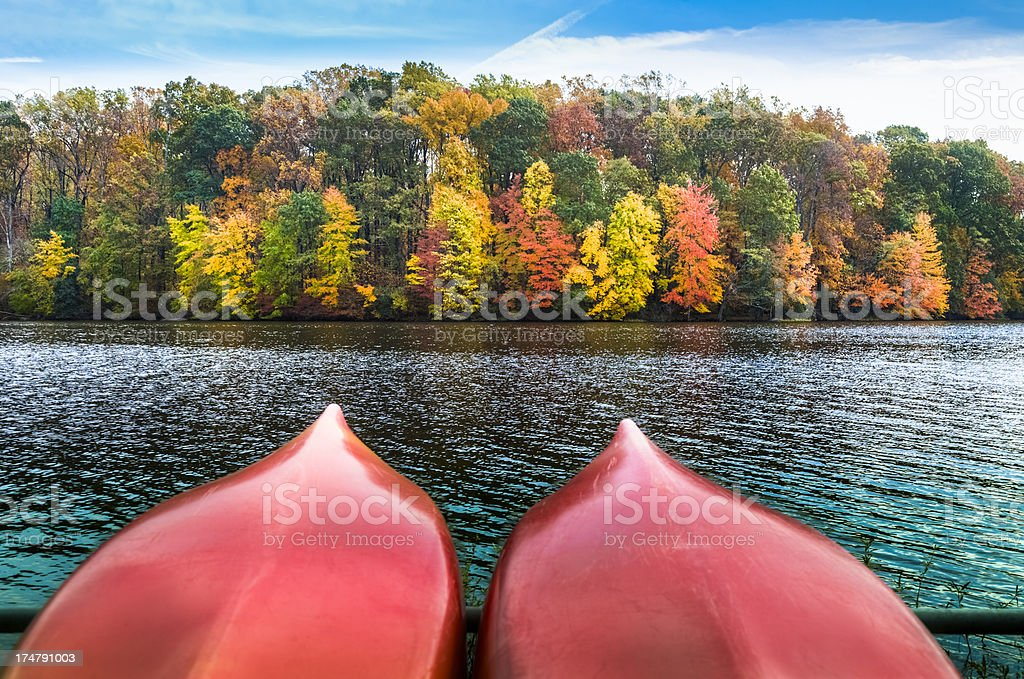 Autumn Lake with Canoes Pointing the way to the Foliage stock photo