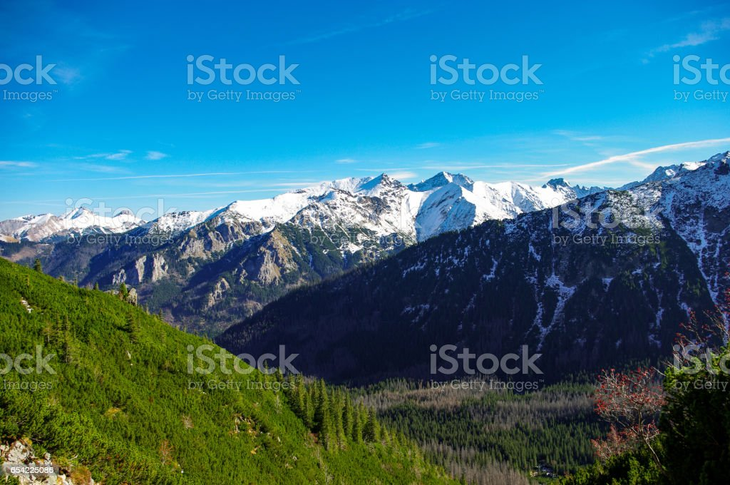 Autumn landscape of great peaks covered with snow. Tatry. stock photo