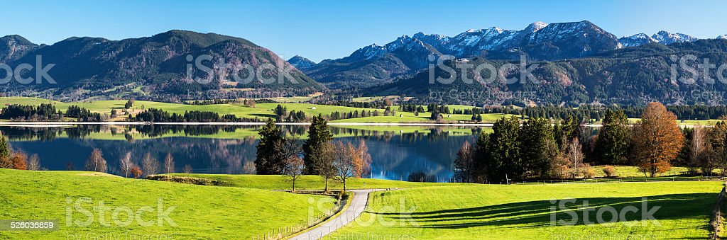 Autumn Landscape with Lake, Alps in Background, Germany stock photo