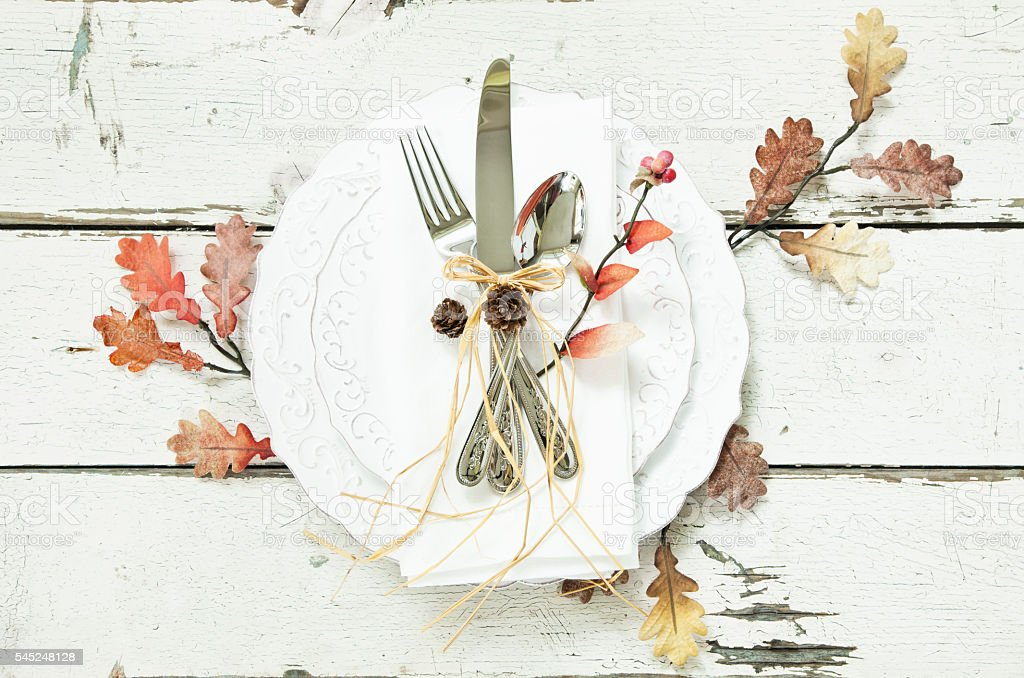 Autumn Leaves Border Dining on Old Wood Background stock photo