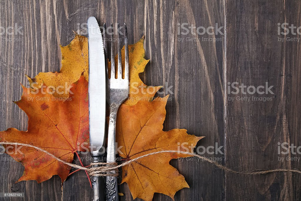 Autumn leaves, knife and fork stock photo