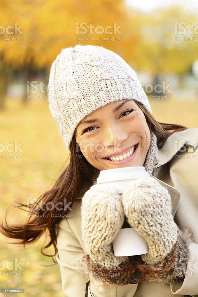 Autumn lifestyle woman drinking coffee royalty-free stock photo