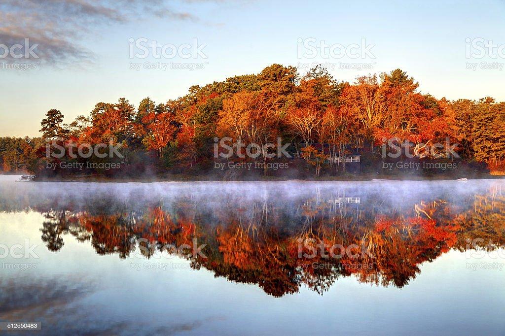 Autumn mist on a small pond in Plymouth, Massachusetts stock photo