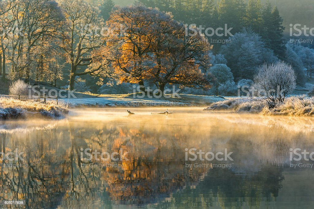 Autumn misty reflections, River Brathay, Lake District. stock photo