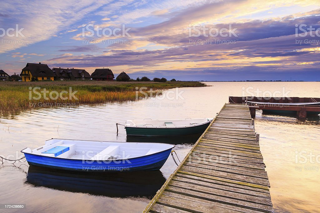 Autumn morning sunrise on a jetty royalty-free stock photo
