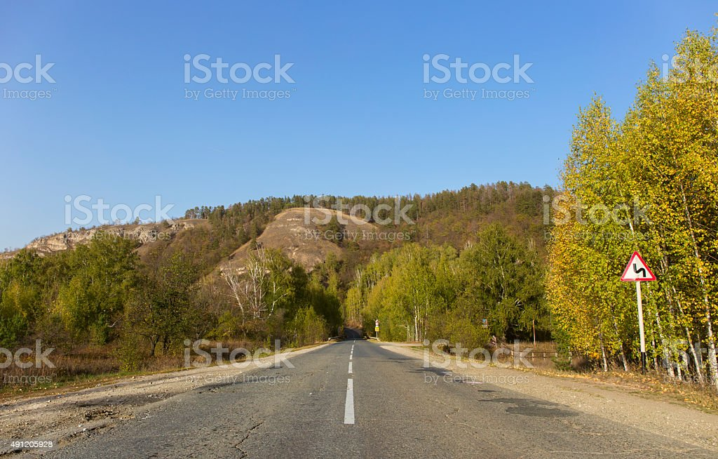 autumn mountains, the winding road sign. stock photo