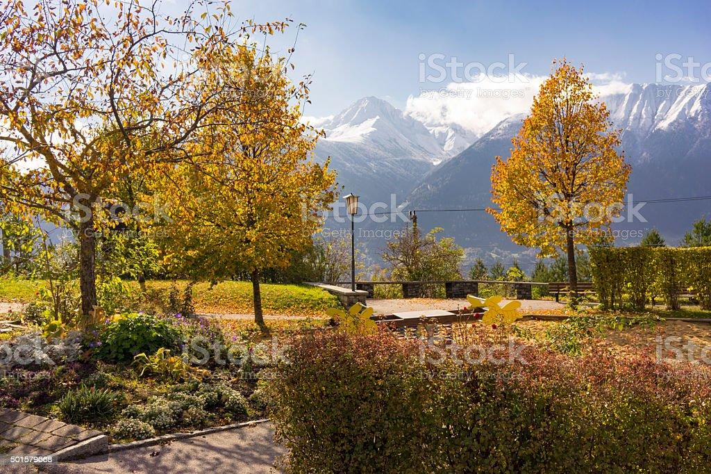 Autumn park overlooking the Austrian alps stock photo