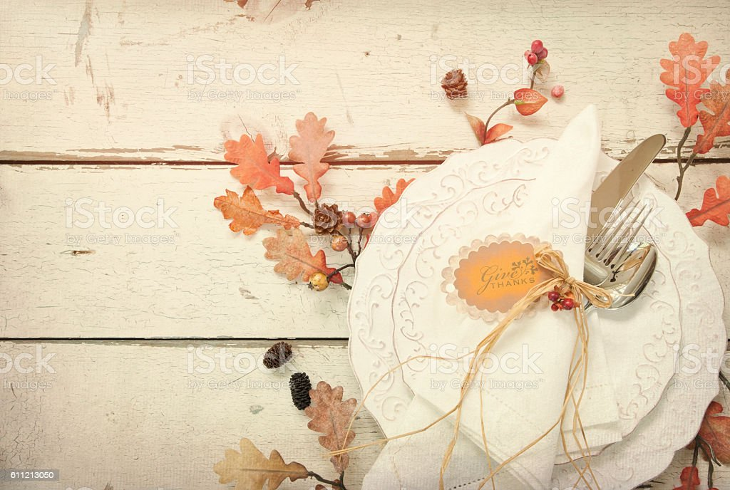 Autumn Place Setting Dining and Leaves on Old Wood Background stock photo
