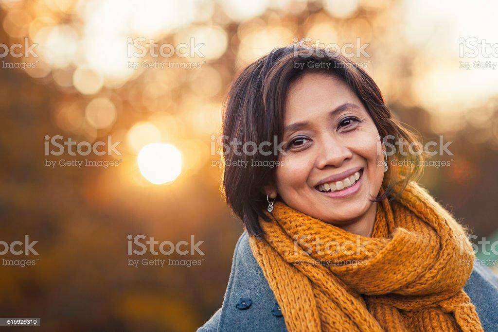 Autumn portrait of a woman stock photo