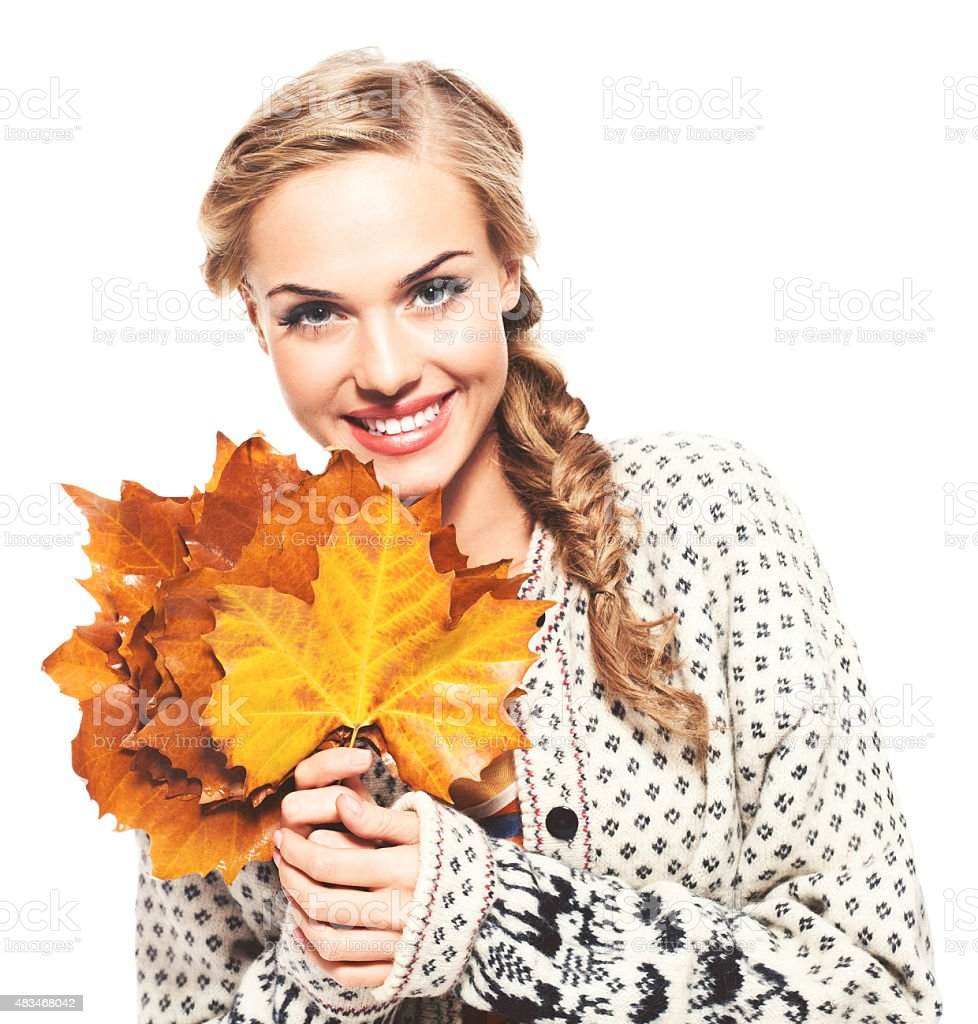 Autumn portrait of cheerful blond hair young woman holding leaves stock photo