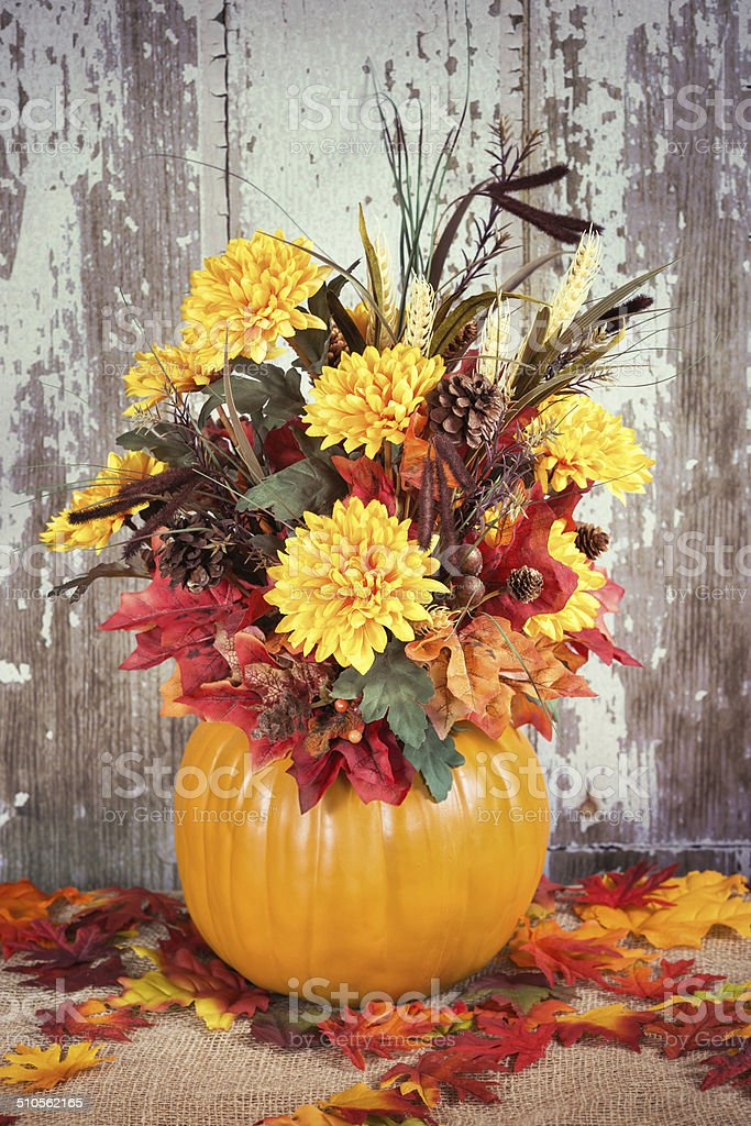 Autumn pumpkin flower arrangement stock photo
