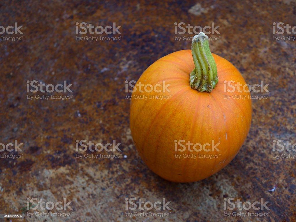 Autumn Pumpkin in Rusty Wheelbarrow stock photo
