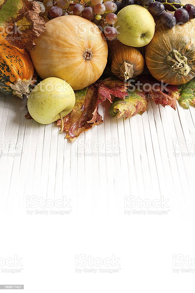 Autumn pumpkins with apple and grapes royalty-free stock photo