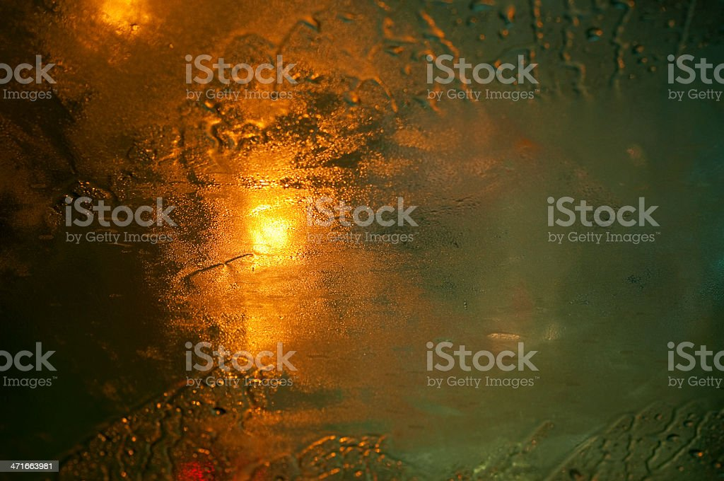 Autumn rain water drops on glass surface and blurry lights royalty-free stock photo