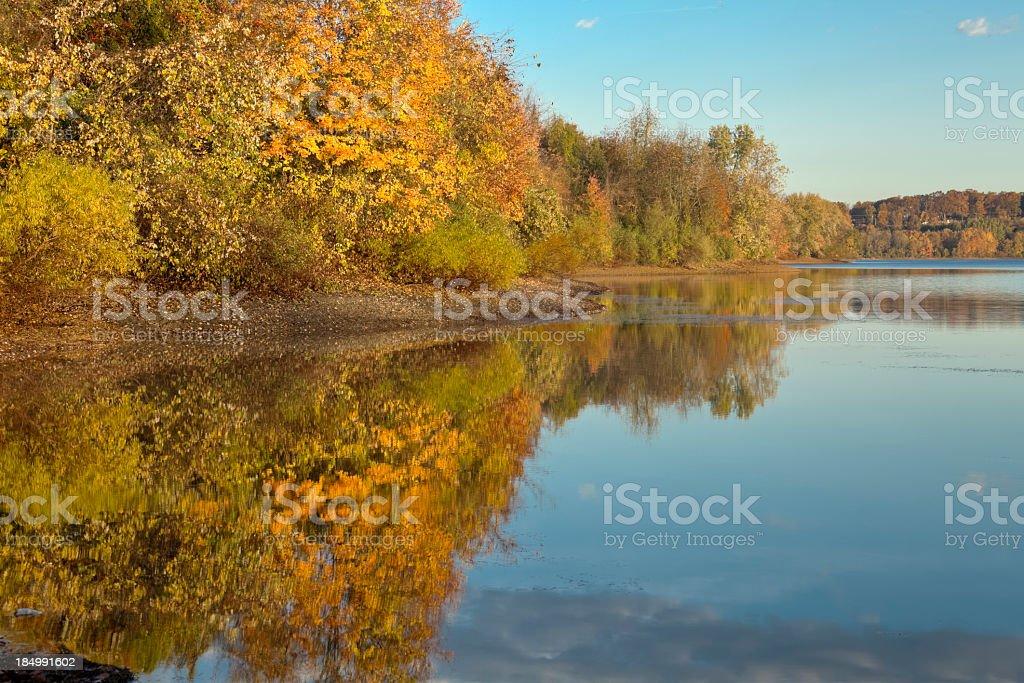 Autumn Reflection on a Glassy Lake stock photo
