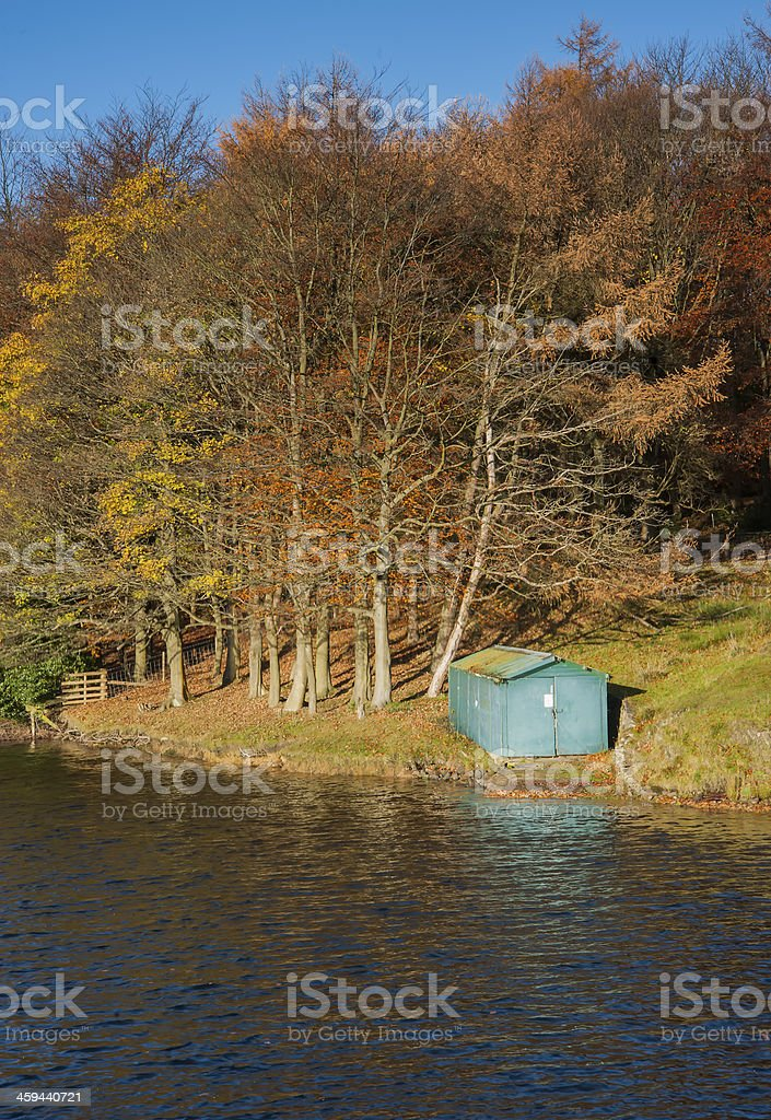 autumn reservoir and fishing hut stock photo