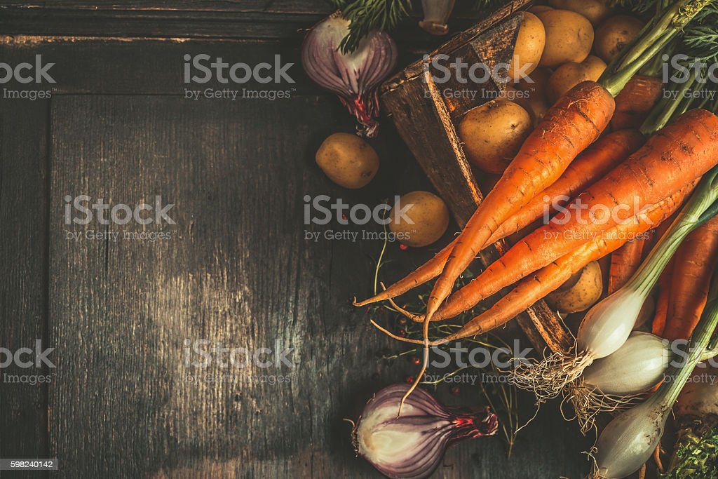 Autumn root vegetables in wooden box , top view stock photo