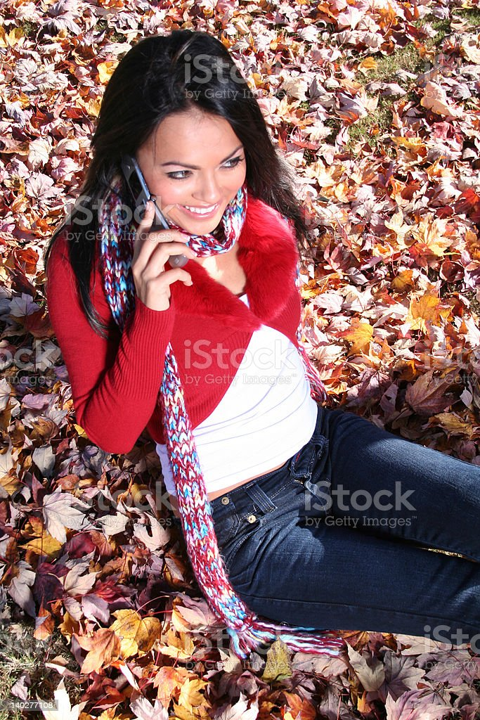 Autumn Scene Fall Woman With Cell Phone royalty-free stock photo