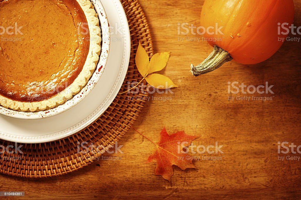 Autumn Scene with Pumpkin Pie Still Life Horizontal stock photo
