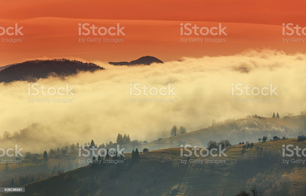 Autumn scenery with cloud inversion and red sunset stock photo