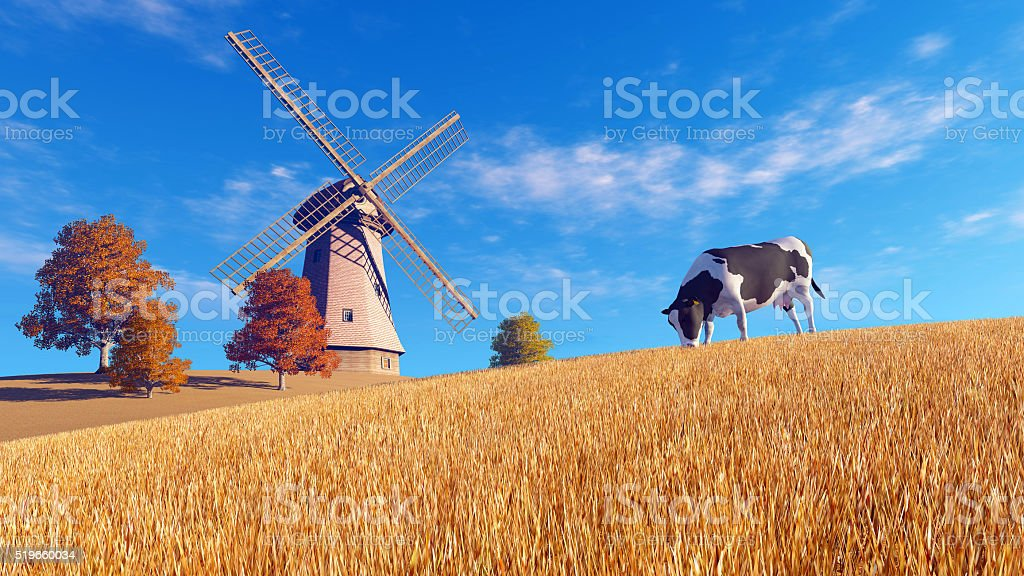 Autumn scenery with cow and windmill stock photo