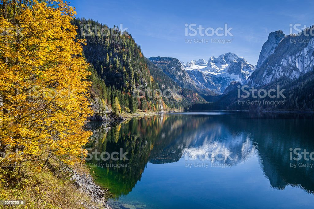 Autumn scenery with Dachstein mountain at Gosausee, Salzkammergu stock photo