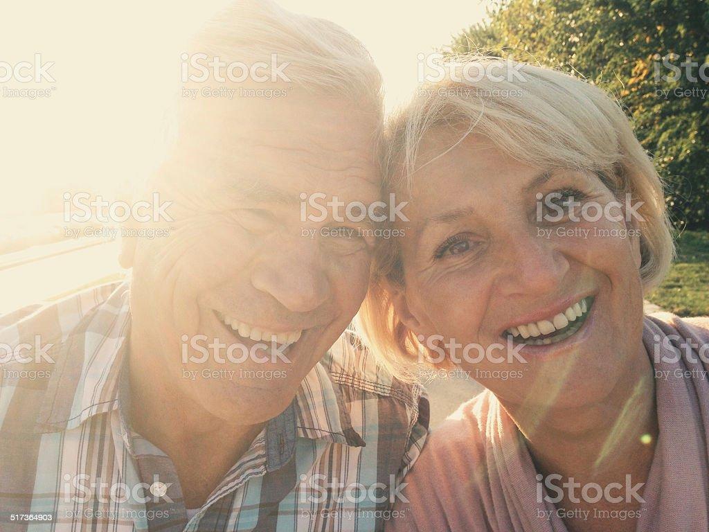 Autumn selfie of smiling senior couple stock photo