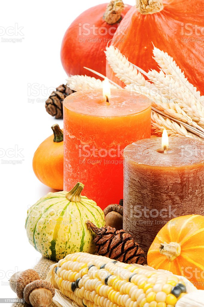 Autumn setting with candles and pumpkins royalty-free stock photo