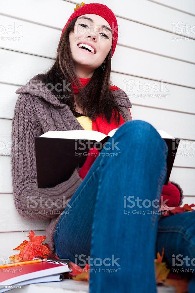 Autumn: Smiling female student studying royalty-free stock photo