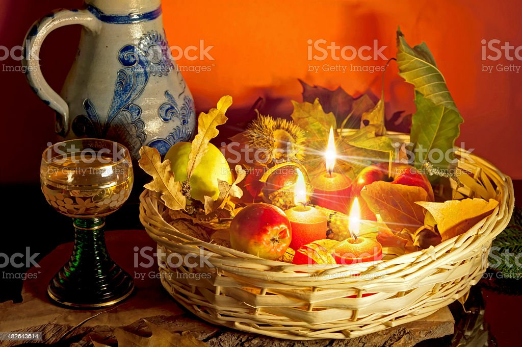 Autumn still life with candlelight and white wine stock photo