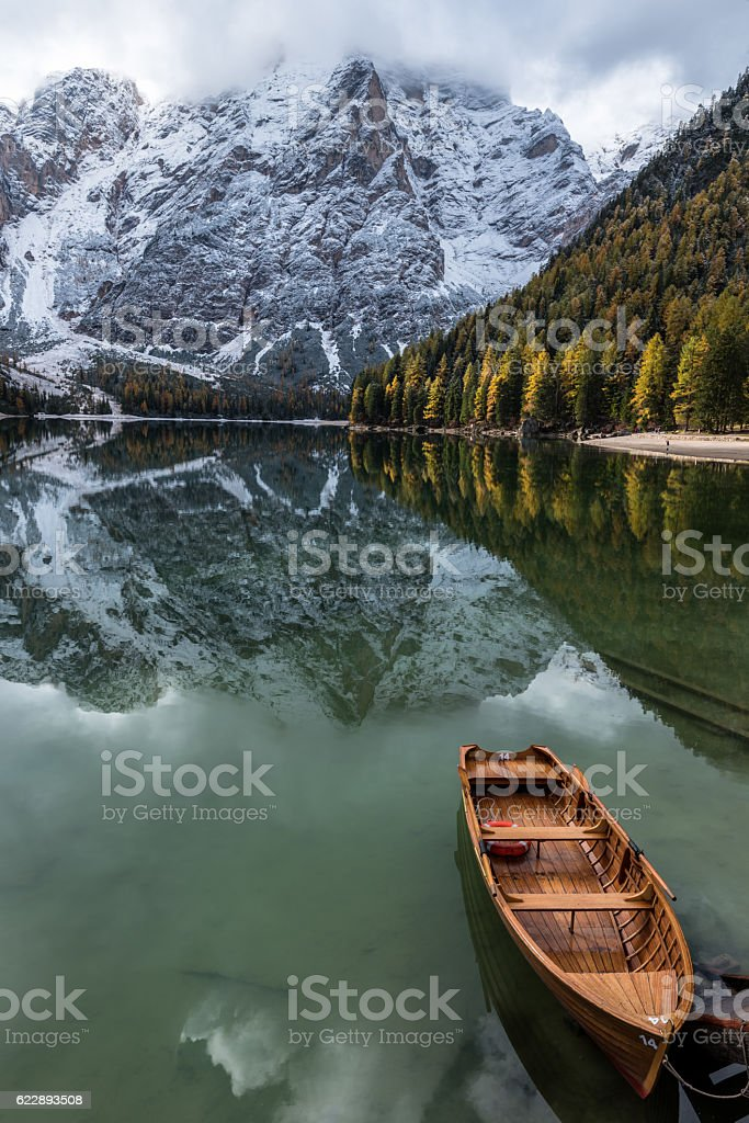 Autumn to Winter transmission at Lago di Braies, Italy stock photo