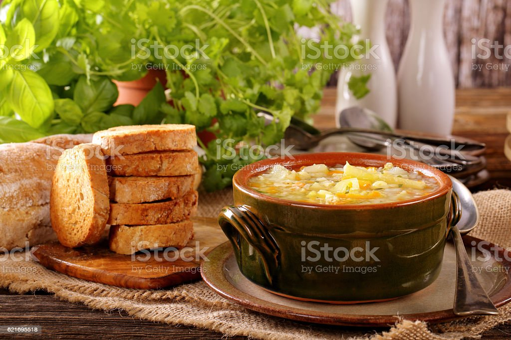 Autumn vegetable soup with toasts and space for text stock photo