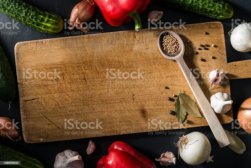 Autumn vegetables, spices, old weathered wooden cutting board, stone table stock photo