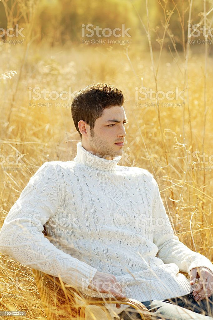 Autumn winter man portrait in outdoor dried grass royalty-free stock photo