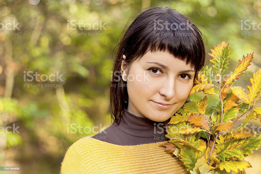 Autumn woman on leafs background royalty-free stock photo