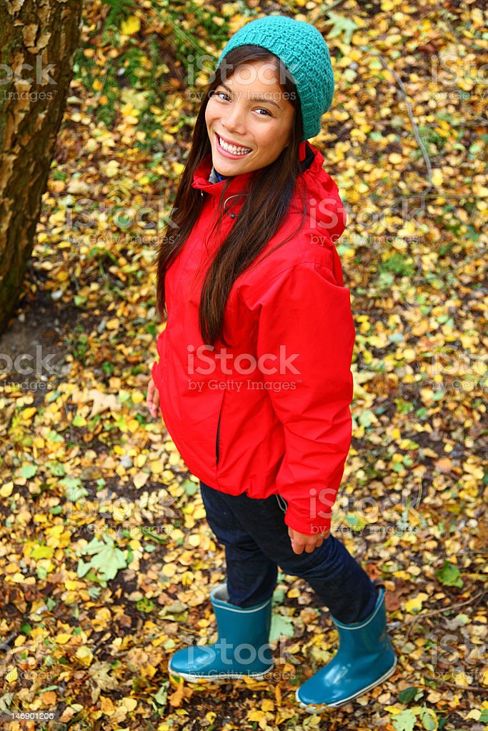 Autumn woman walking in forest stock photo