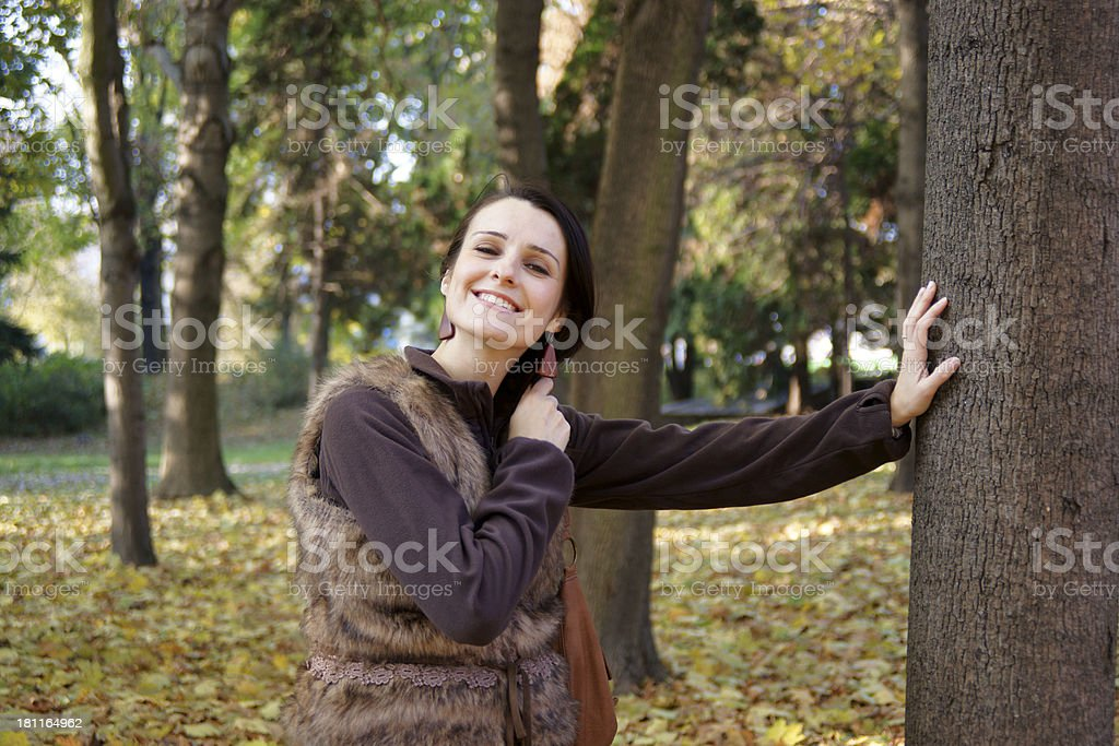 Autumn woman wearing fur vest royalty-free stock photo