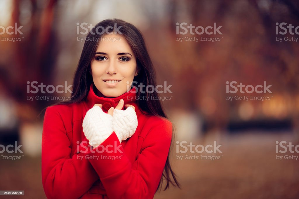 Autumn Woman Wearing Red Coat and Knitted Fingerless Gloves stock photo