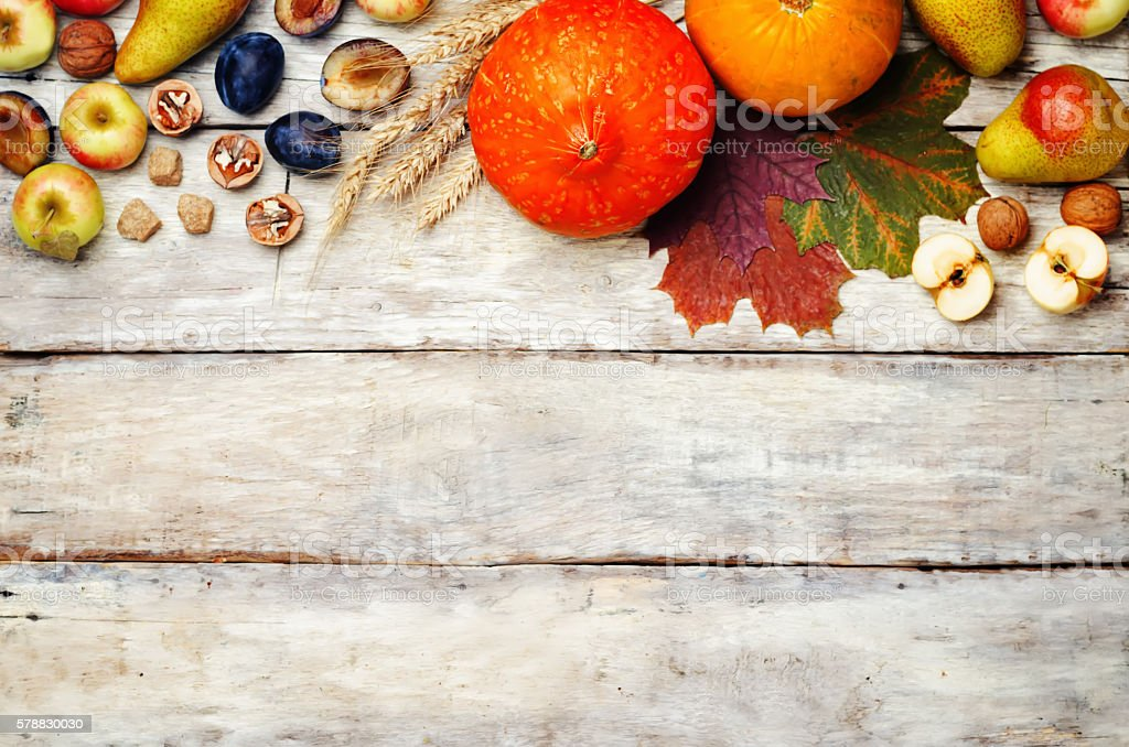 autumn wood White background with pumpkin, fruit, nuts and wheat stock photo