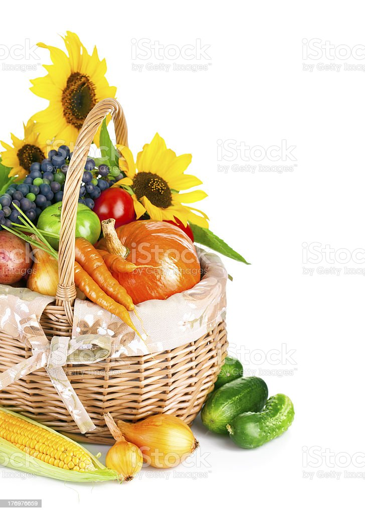 autumnal harvest vegetables and fruits in basket royalty-free stock photo