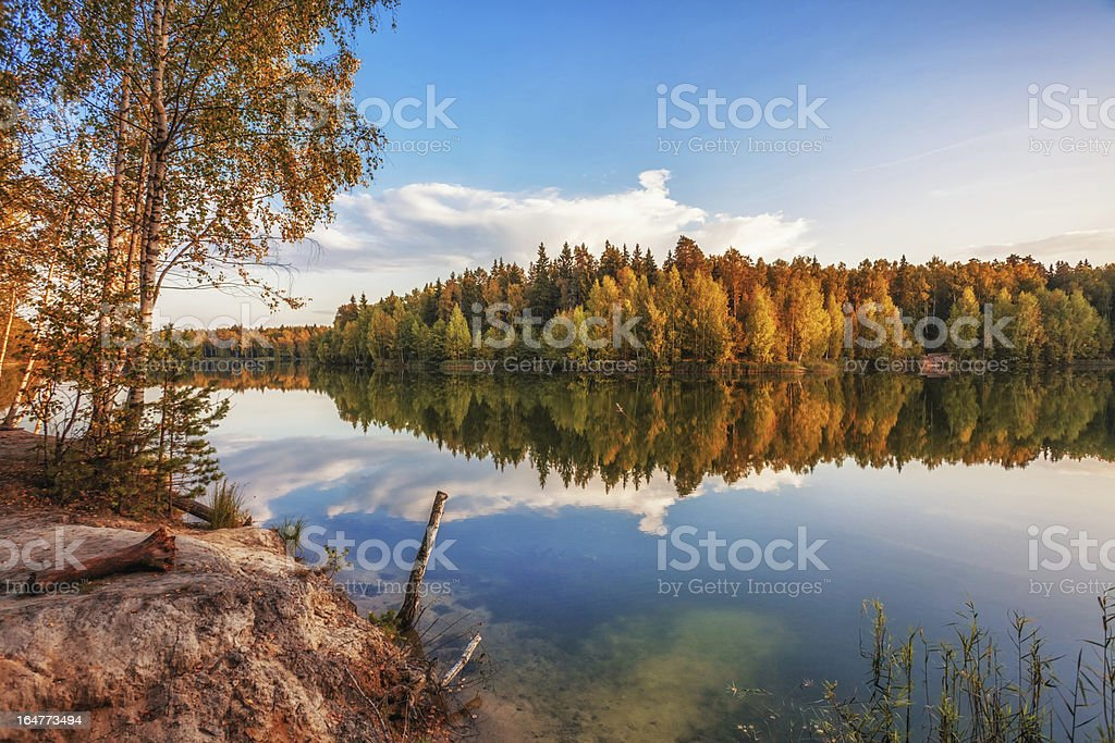 autumnal lake near the forest royalty-free stock photo