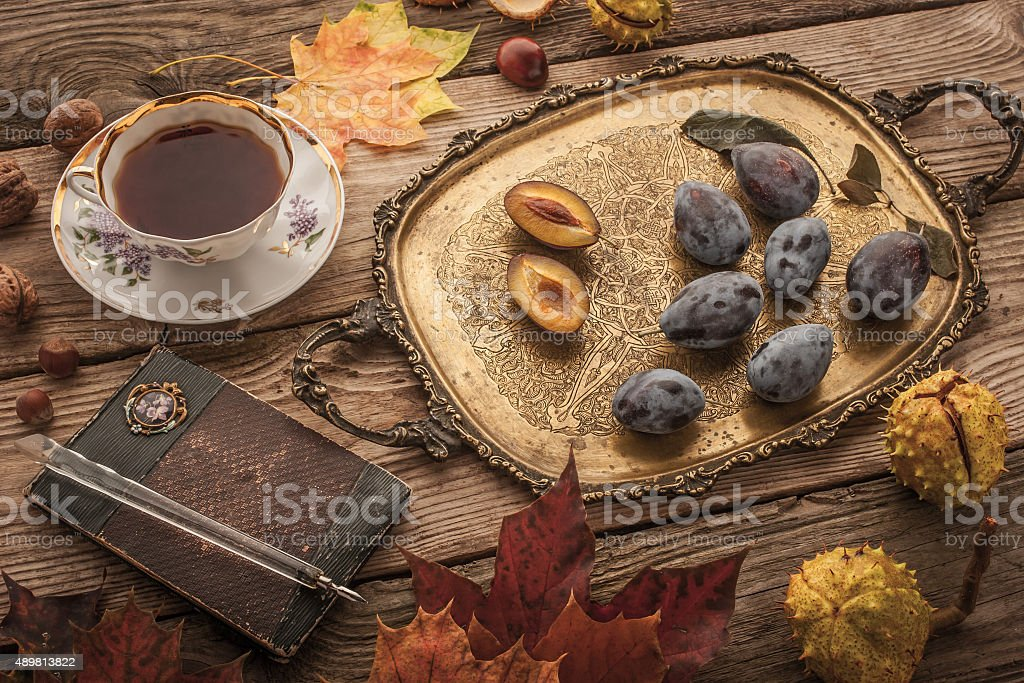 Autumnal still life with  gift of nature , notebook and tea stock photo
