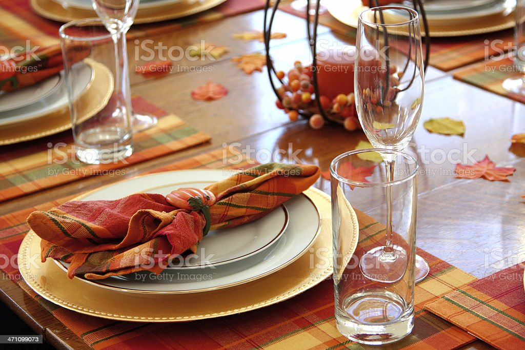 Autumnal table settings on orange placemats stock photo