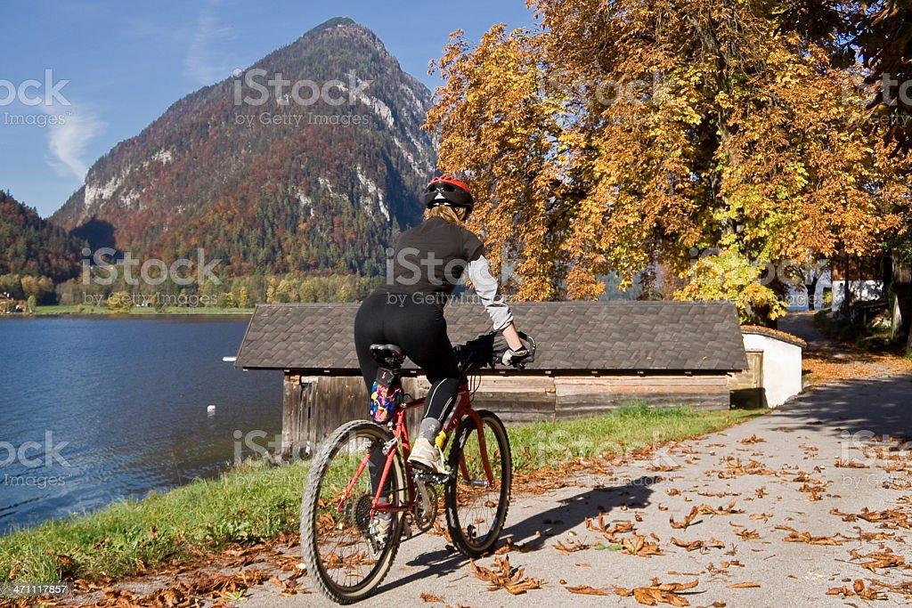 Autumn-biking lakeside royalty-free stock photo