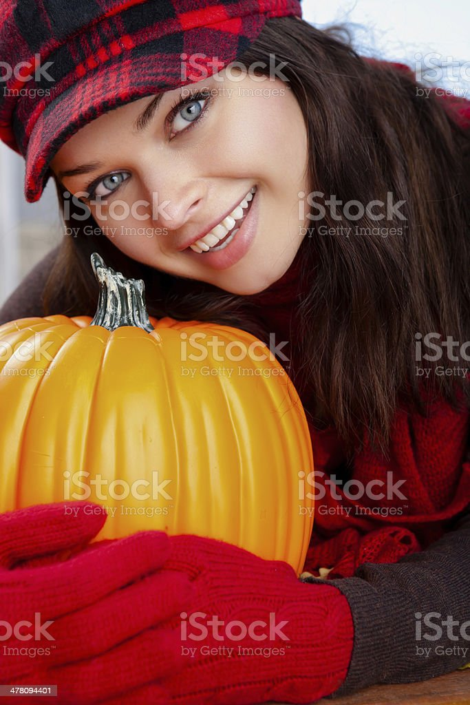 Autumn-Smiling woman holding pumpkin on deck royalty-free stock photo