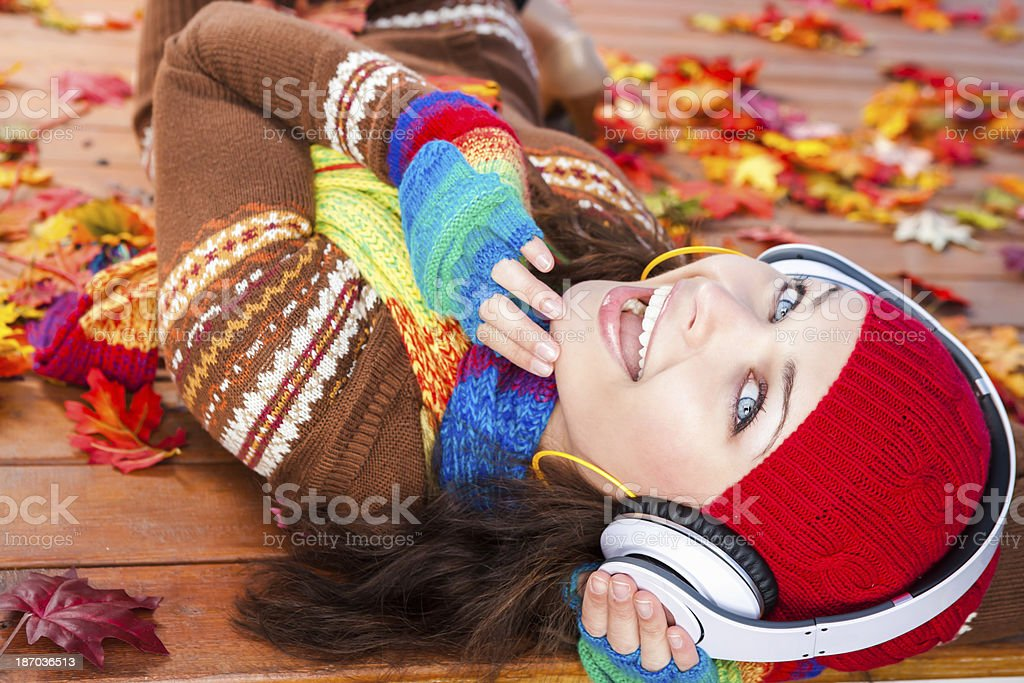 Autumn-Smiling woman with headphones royalty-free stock photo