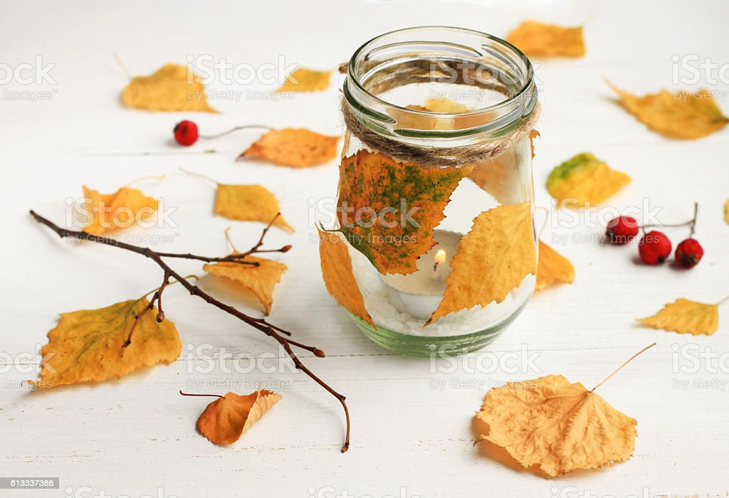 Autumn-themed DIY candle. stock photo