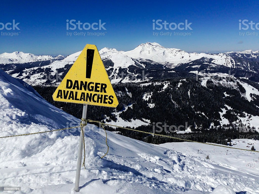 Avalanche danger sign in a mountain landscape stock photo